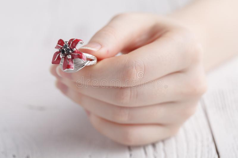 Close up of an elegant ring on the young woman`s finger stock image