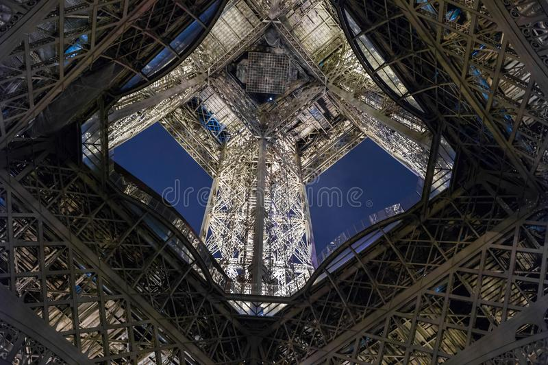 Close-up element part of Eiffel tower at evening winter time stock photography