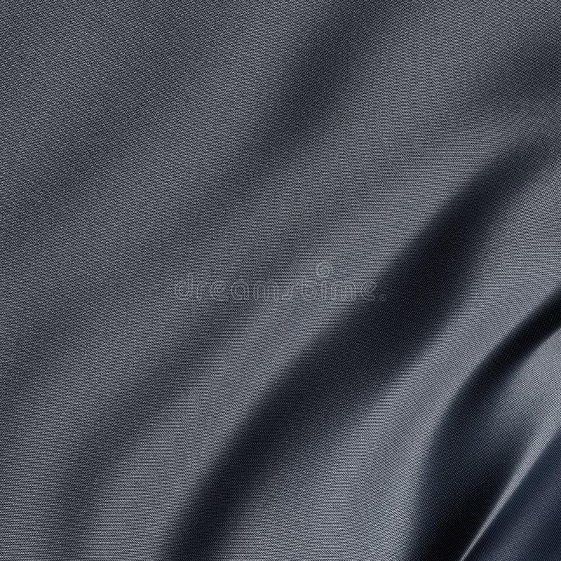 Close-up em uma folha cinzenta sintética com reflexão levemente azul ilustração stock