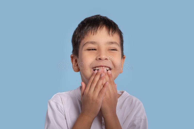 Close up emotional portrait of little boy wearing a white shirt stock images