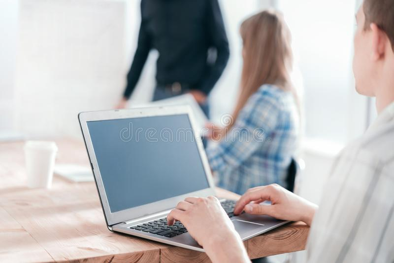 Close up. employee working laptop in the office royalty free stock photo