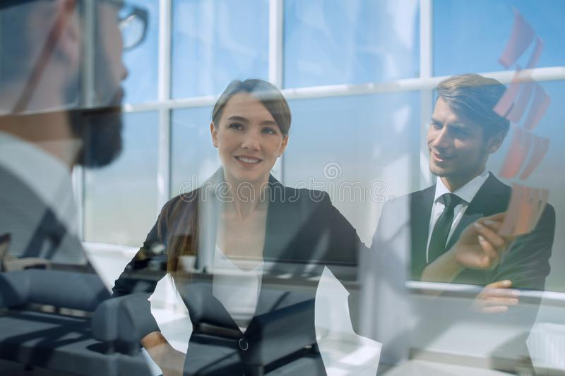 Close up.employees on the background of a modern office stock photo