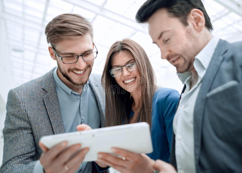 Close up.employees using a digital tablet royalty free stock image