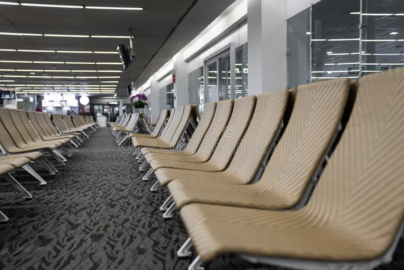 Close up of empty artificial rattan seater in the airport / waiting lounge airport / artificial rattan material / travel passenger. Concept royalty free stock images