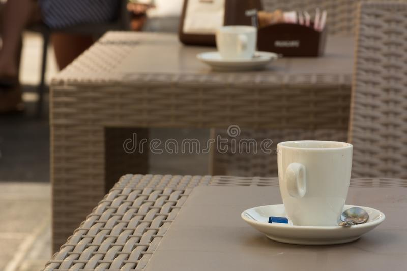 Close Up of Empty Cup of Coffee on a Table of an Italian Bar. On Blur Background, aroma, beverage, break, breakfast, brewed, cafe, cafeteria, caffeine royalty free stock photo