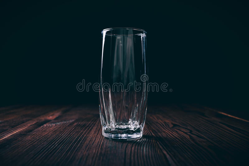 Close-up of an empty faceted glass on a black background stock photo