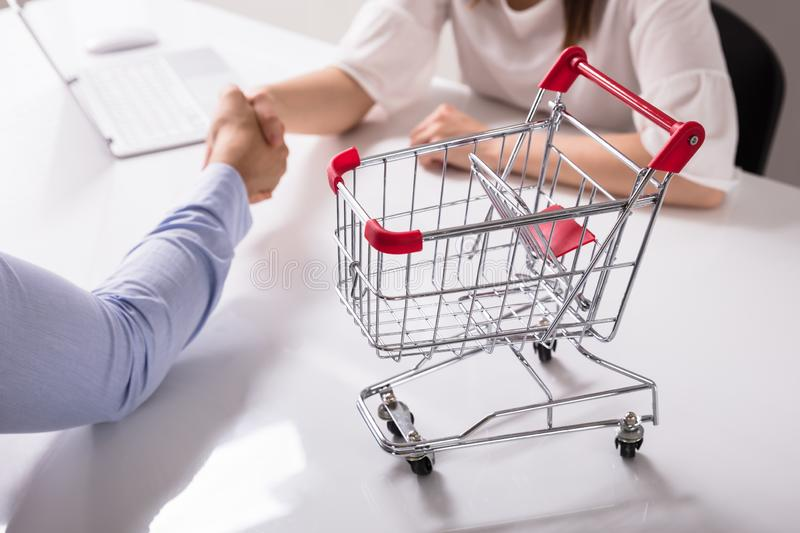Close-up Of Empty Shopping Cart On Desk royalty free stock photo