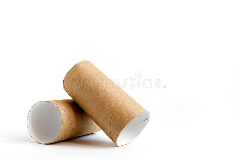 Close-up of empty toilet rolls. Two cardboard paper tubes on white background. Copy space royalty free stock image
