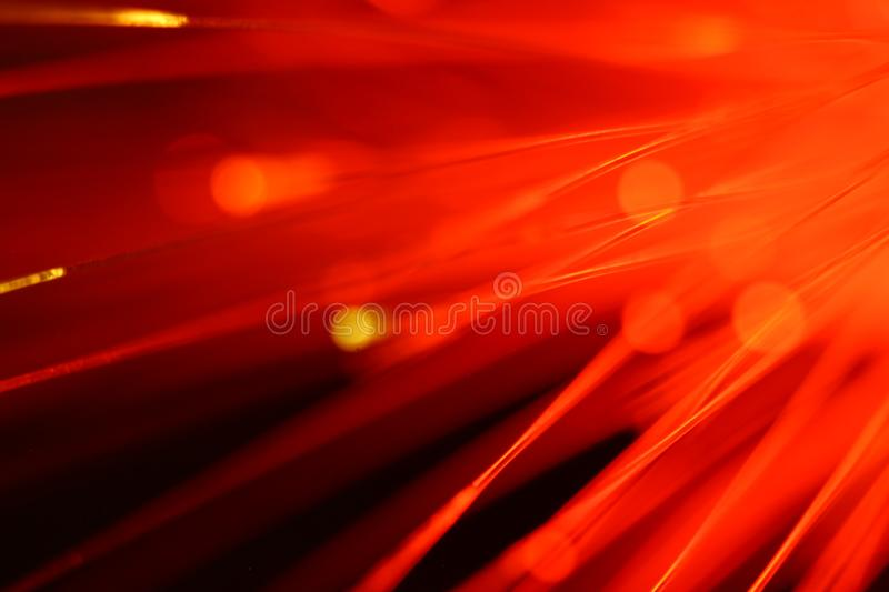 Close up on the ends of a selection of illuminated red fiber optic light strands royalty free stock photography
