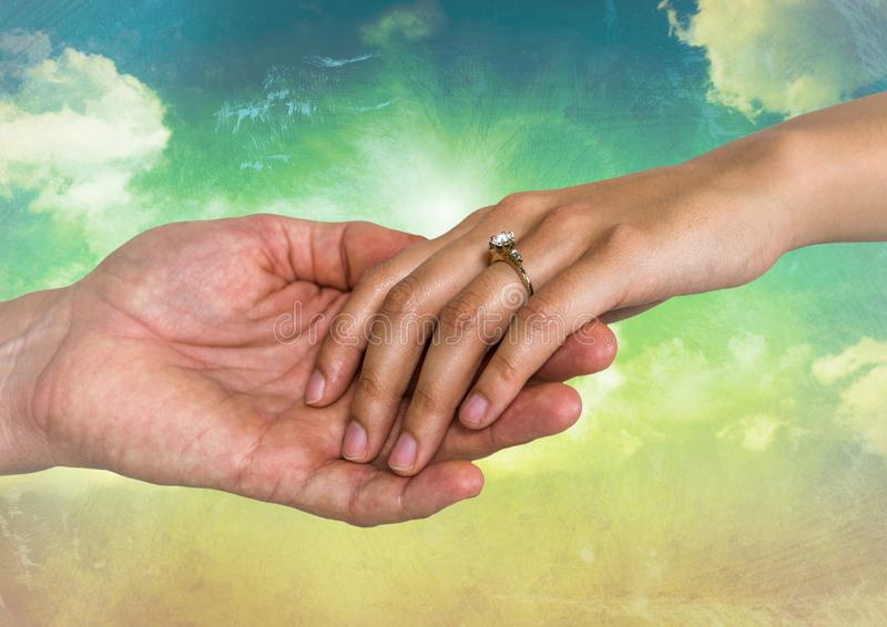Close-up of engaged couple holding hands each other stock photo