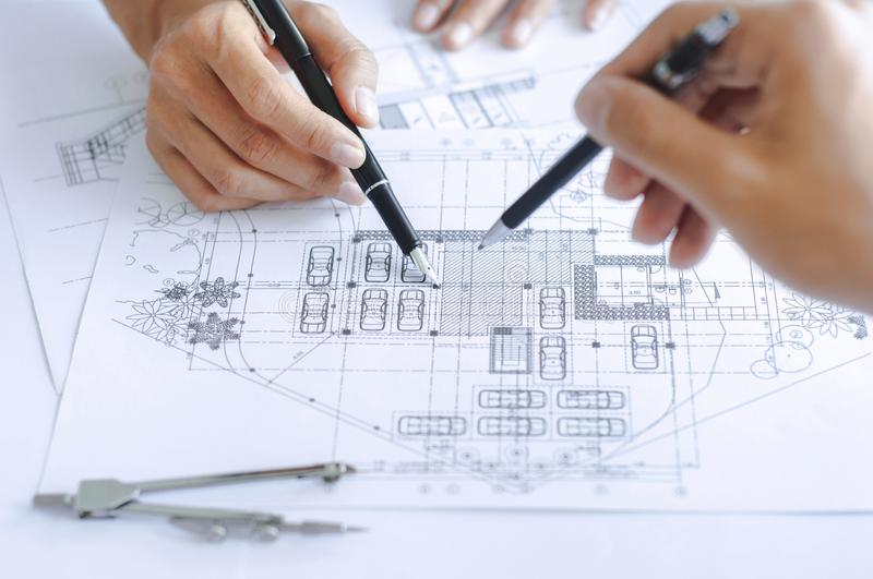 Close-up engineer team Drawing Plan on Blue Print with architect equipment royalty free stock images