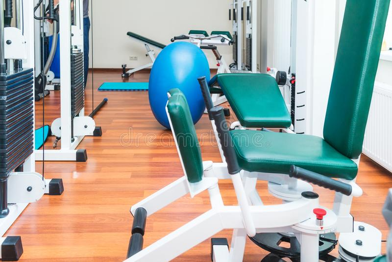 Close up equipment for rehabilitation in interior of physiotherapy clinic. Physical therapy center. Selective focus, copy space royalty free stock photo