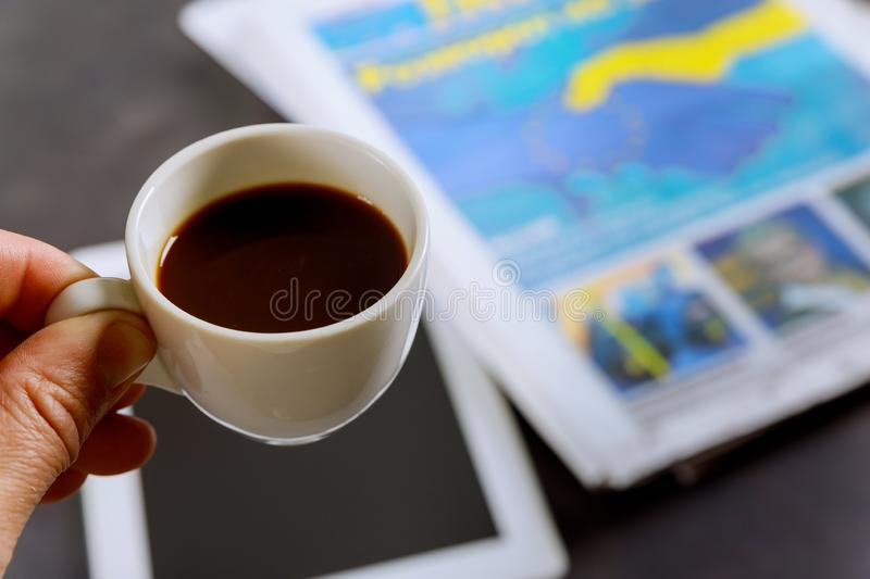 Close up espresso coffee cup on newspaper the table royalty free stock photography