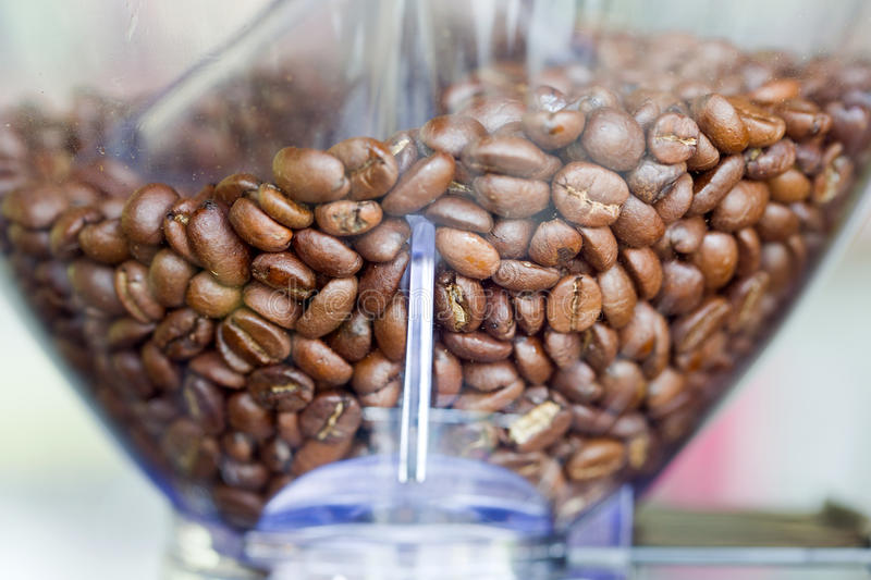 Close-up espresso coffee machine with roasted coffee beans. stock photography
