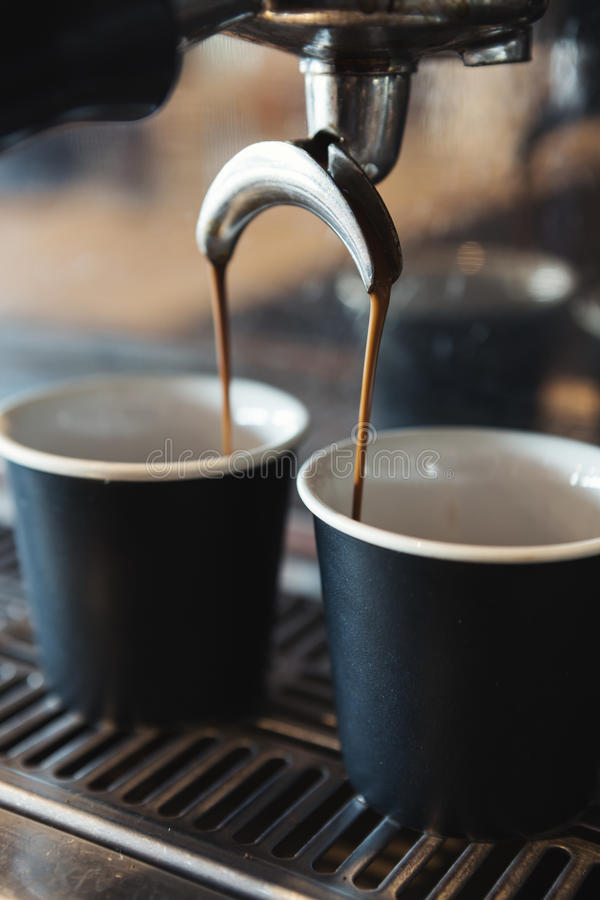 Close up of espresso machine making coffee in a cafe stock photo