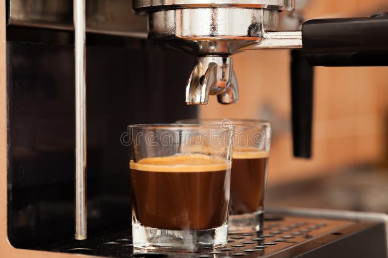 Close-up of espresso. Pouring from coffee machine stock images