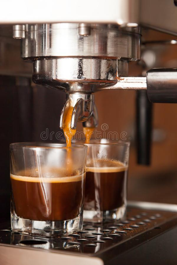 Close-up of espresso. Pouring from coffee machine stock image