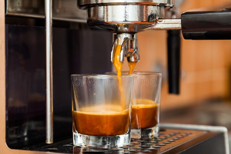 Close-up of espresso. Pouring from coffee machine royalty free stock photo