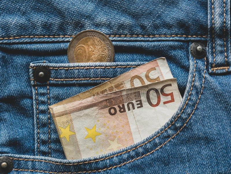 Close up of a 50 euro banknote in a pocket. Close up of a 50 euro banknote in a Jeans pocket 2 finance background bill black blue business cash casual closeup royalty free stock images