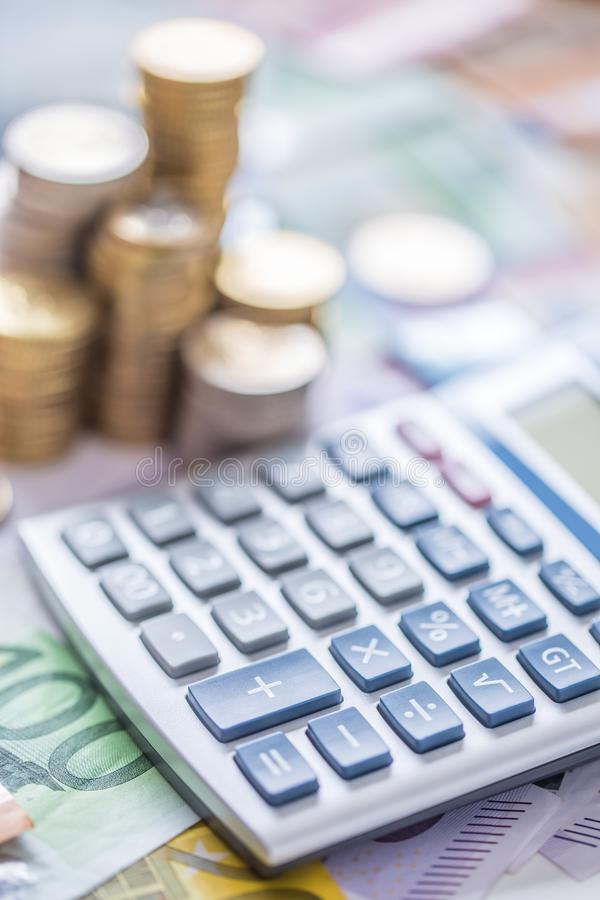 Close-up euro coins and banknotes with calculator royalty free stock photos