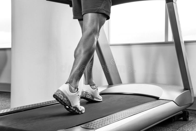 Close-up Exercising On A Stepper. Close Up Of Male Legs Exercise On Stepper royalty free stock photography