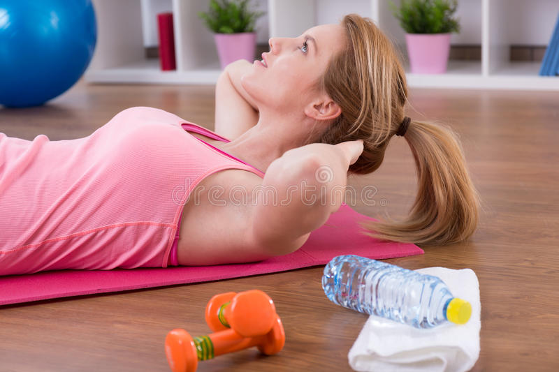 Close-up of exercising woman royalty free stock image