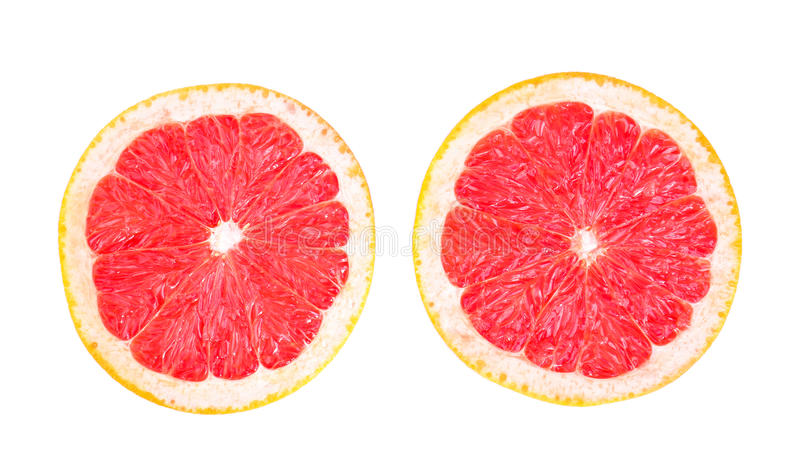 Close-up exotic citruses isolated on a white background. A saturated red grapefruit perfectly sliced in half. Vitamin C. stock images