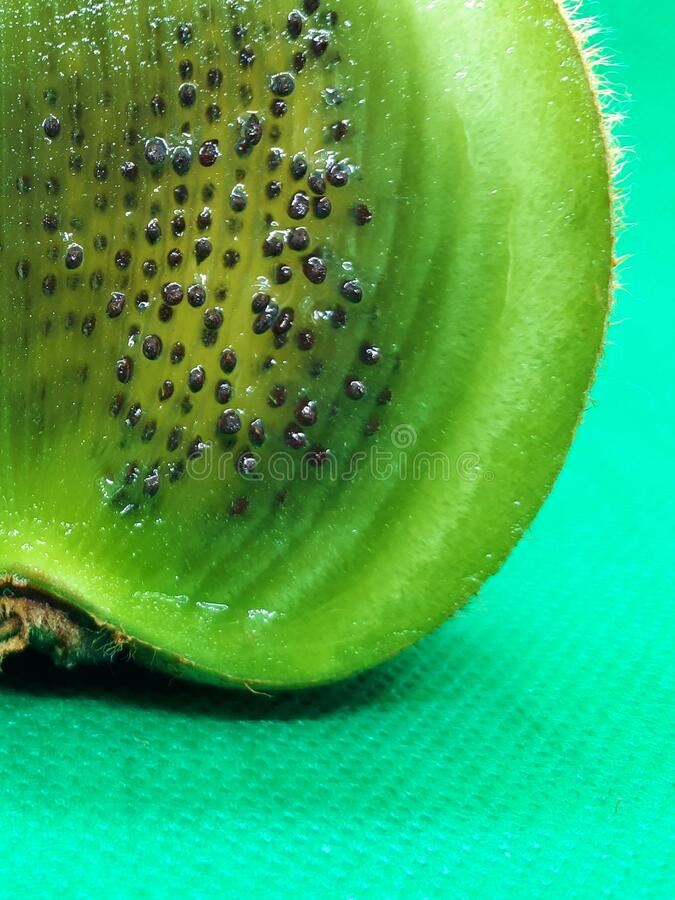 Close-up of exotic fruit, green juicy ripe raw kiwi sliced into slices on an abstract background.  stock photos