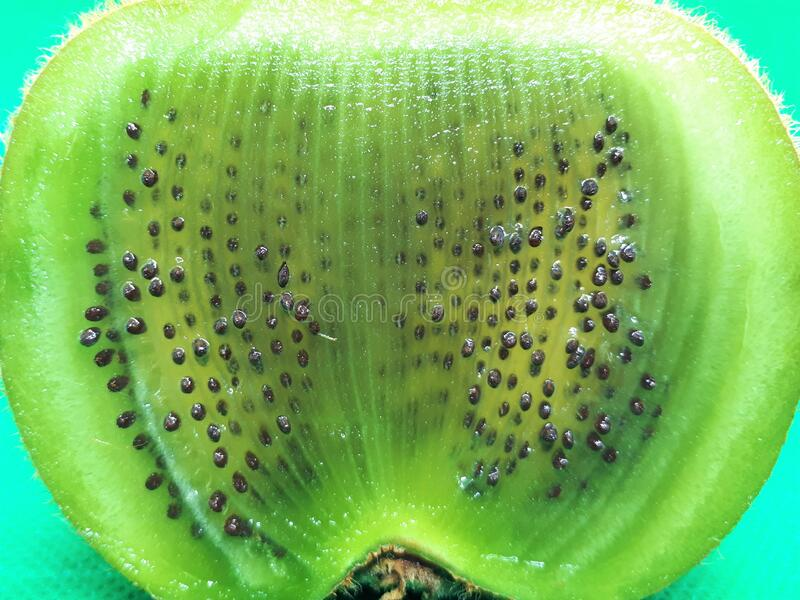 Close-up of exotic fruit, green juicy ripe raw kiwi sliced into slices on an abstract background.  royalty free stock image