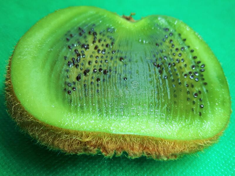"""Close-up of exotic fruit, green juicy ripe raw kiwi sliced """"‹""""‹into slices on an abstract background.  royalty free stock photography"""