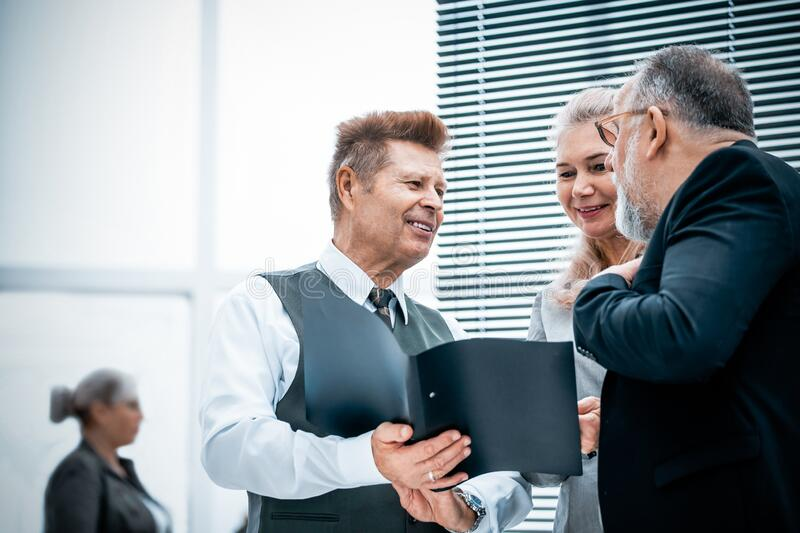 Close up. experienced company employees discussing business documents stock photo