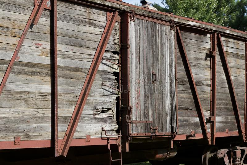 Close up exterior view of an old 19th Century railroad train boxcar. Close up exterior view of an old weathered wooden red painted 19th Century railroad train stock image