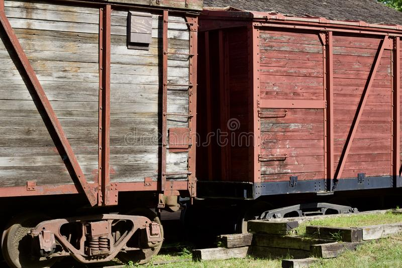 Close up exterior view of an old 19th Century railroad train boxcar. Close up exterior view of an old weathered wooden red painted 19th Century railroad train stock photo