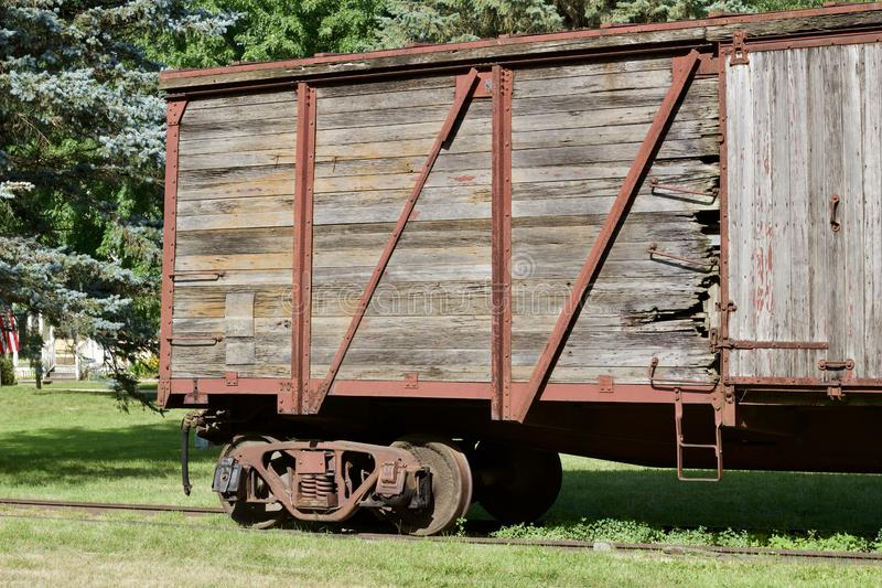 Close up exterior view of an old 19th Century railroad train boxcar. Close up exterior view of an old weathered wooden red painted 19th Century railroad train royalty free stock photo