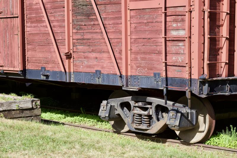 Close up exterior view of an old 19th Century railroad train boxcar. Close up exterior view of an old weathered wooden red painted 19th Century railroad train stock photos