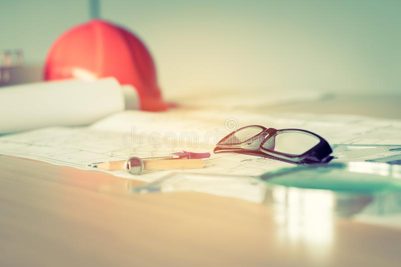 Close up of eye glasses on blueprint on the office room. stock image