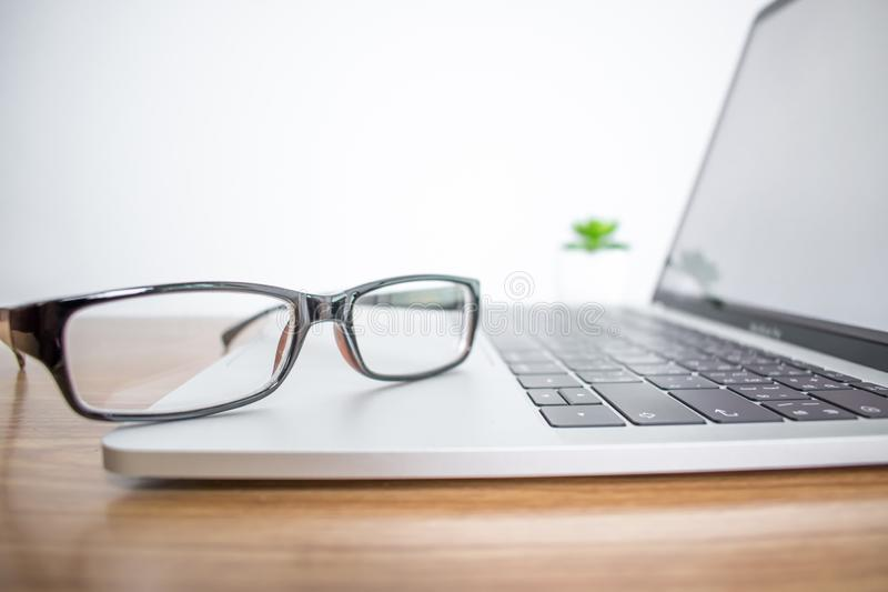 Close up. Eyeglasses of a businessman on a computer in the office royalty free stock photos