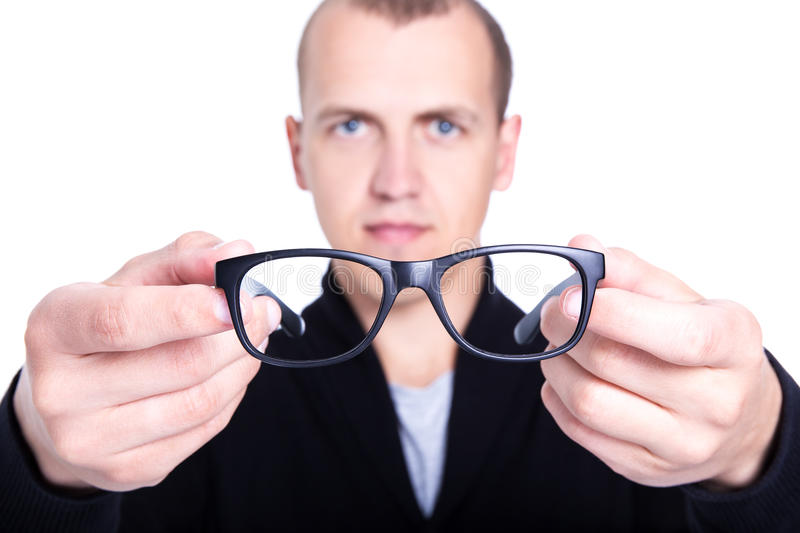 Close up of eyeglasses in male hands isolated on white stock photo