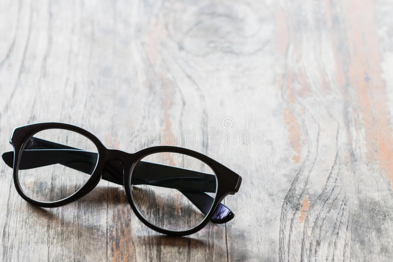 Close up eyeglasses on old wooden table. copy space. Object royalty free stock image