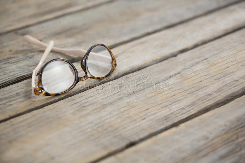 Close up of eyeglasses on table. Close up of eyeglasses on wooden table stock images