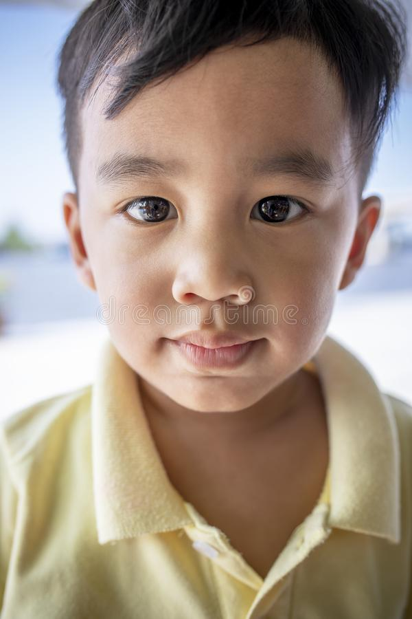 Close up face asian children looking eyes contact to camera royalty free stock photography