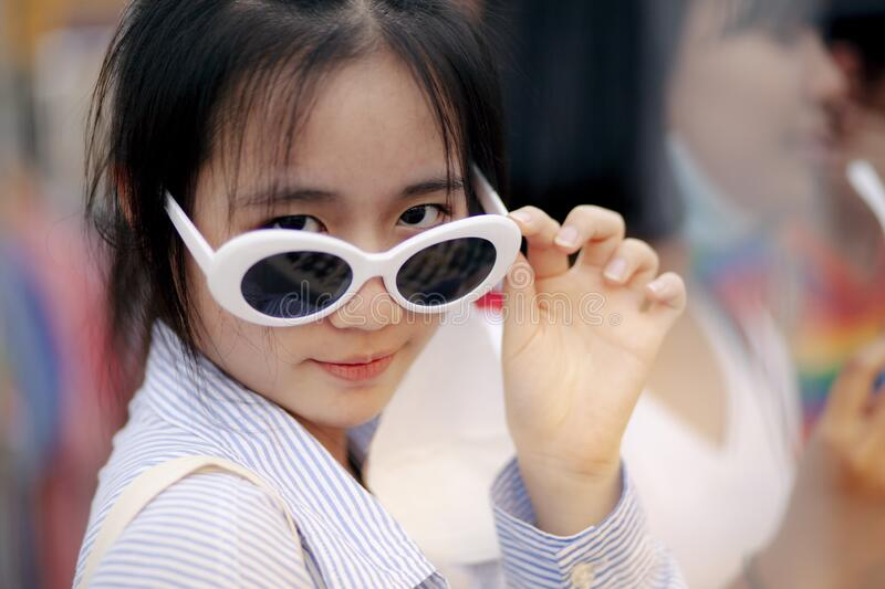 Close-up face of asian teenager wearing fashion eye glasses stock photos