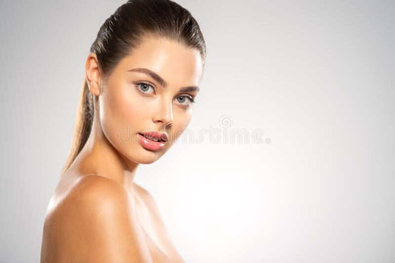 Close-up face of beautiful woman looks to the camera royalty free stock photos