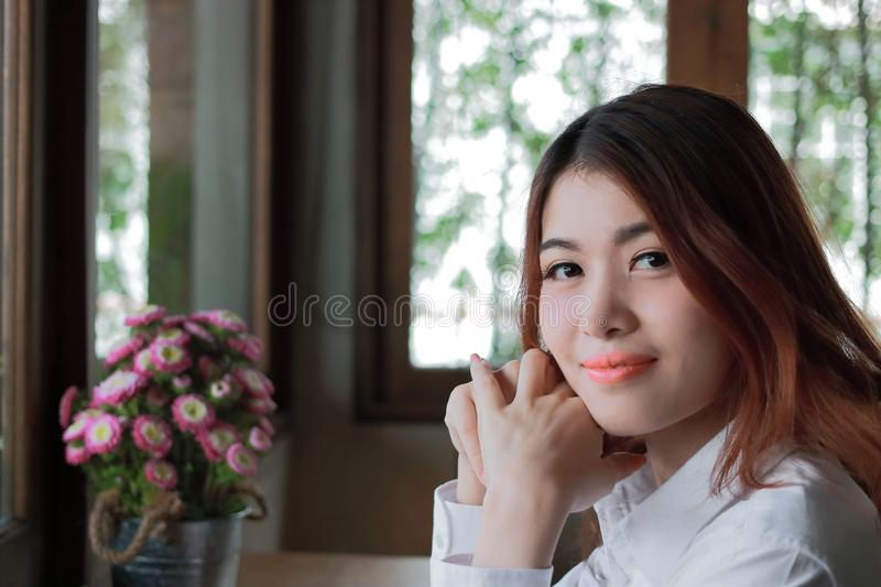 Close up on face of beautiful young Asian woman looking at camera with copy space. royalty free stock images