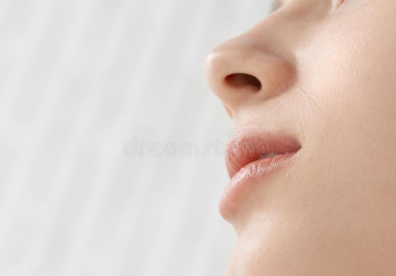 Close up of face and lips of beautiful woman. royalty free stock photography