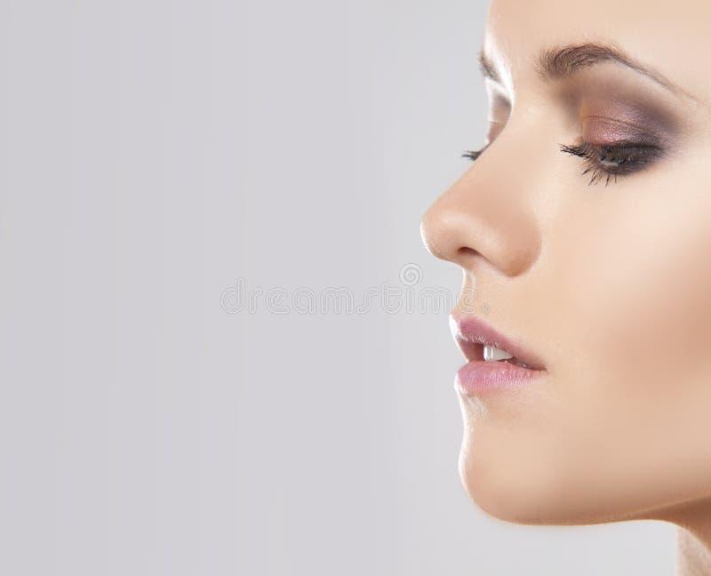 Close up face portrait of a woman stock photo
