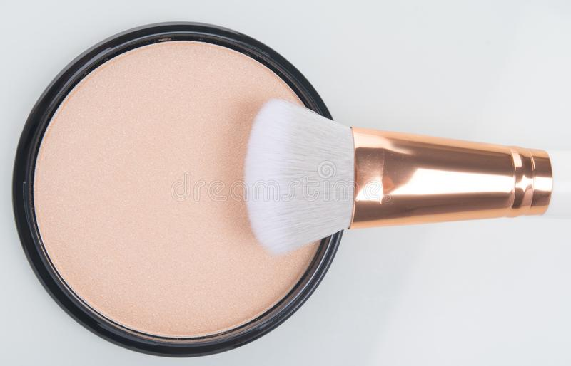 Close-up of face powder to smooth the makeup brush on white background stock images