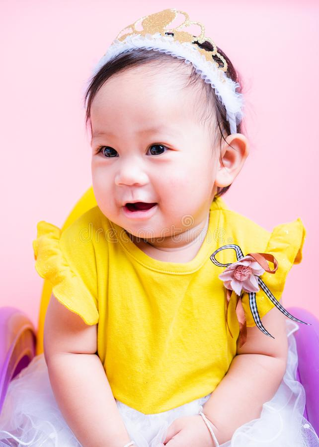 Close up face princess little baby girl in beautiful dress she is smile in studio stock image