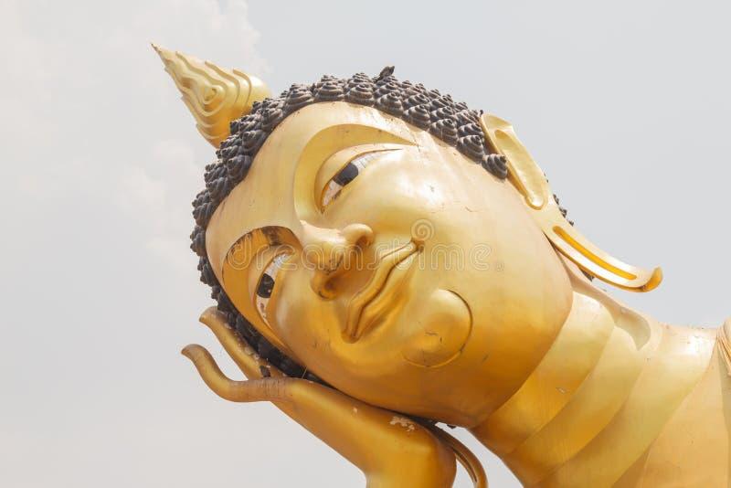 Close up of the face of Reclining Buddha in Wat Kok Mai Daeng, P royalty free stock photos