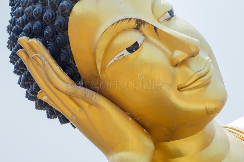 Close up of the face of Reclining Buddha in Wat Kok Mai Daeng, P stock image